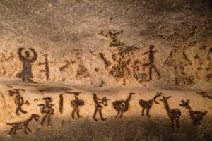 Archeologists discover cave drawings of Pitocin infusion on post partum woman