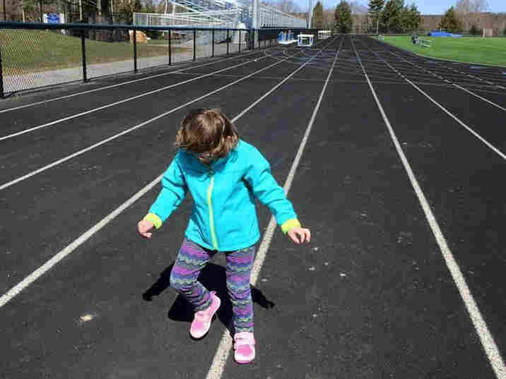 Tess Bigelow stomps it out on the track where she prepares to compete in the Special Olympics.