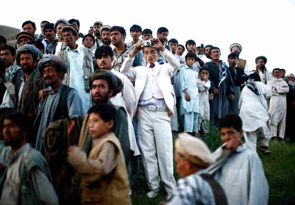 Afghan president Hamid Karzai holds a rally in a remote village in 2009.
