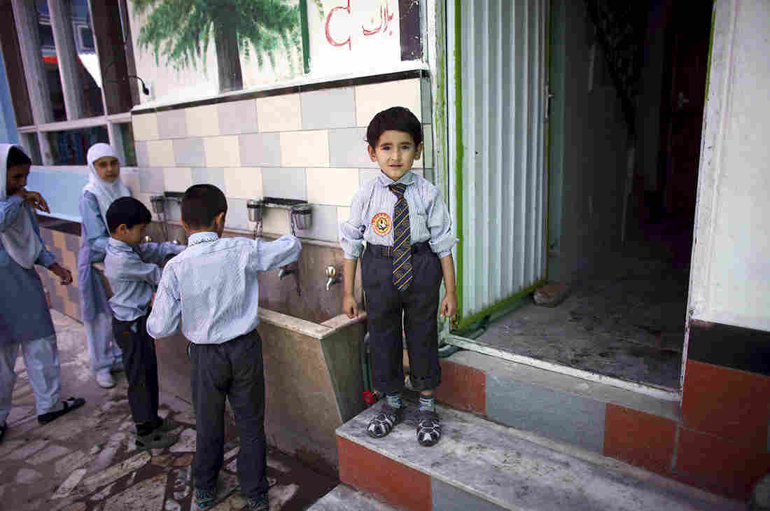"""An Afghani child was one of Gilkey's """"little buddies."""""""