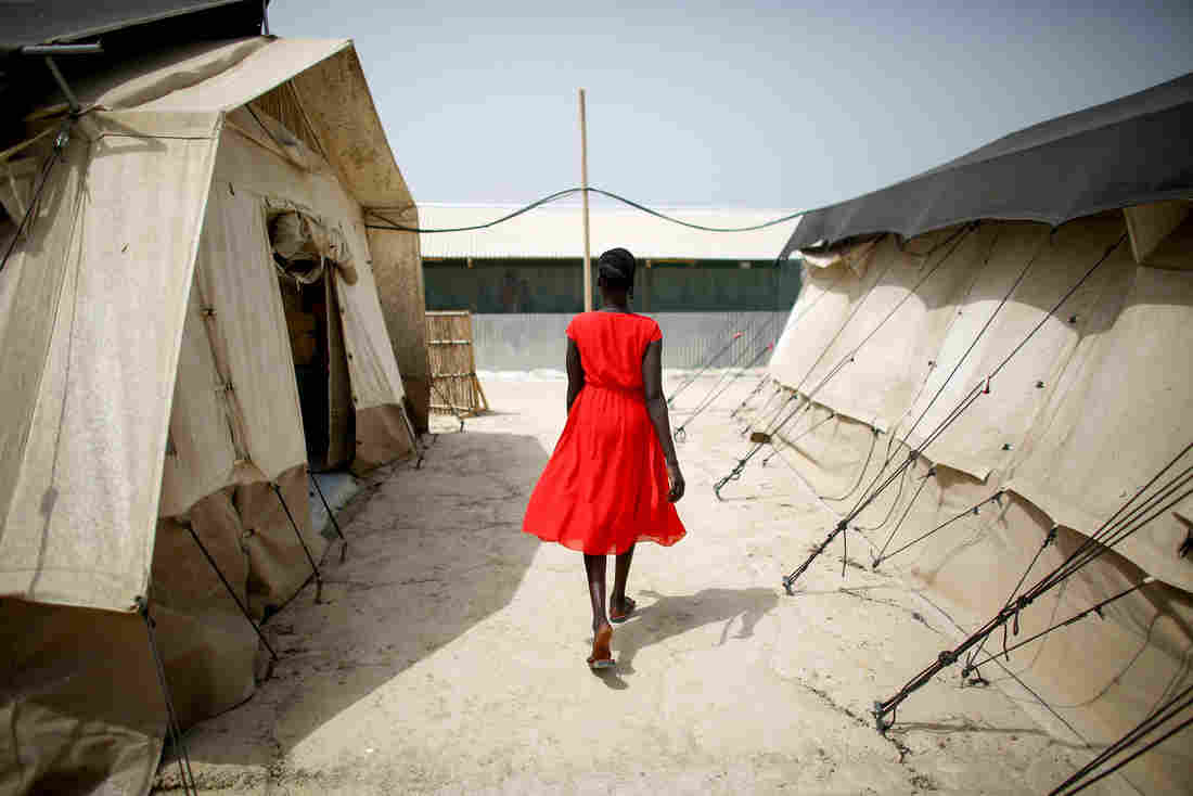 A woman walks between tents that house the hospital wards at a camp for displaced persons in South Sudan. The photo was taken in February.